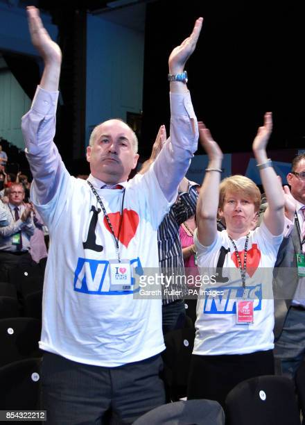 Party supporters applaud the speech of shadow health secretary Andy Burnham at the annual Labour Party conference in Brighton East Sussex