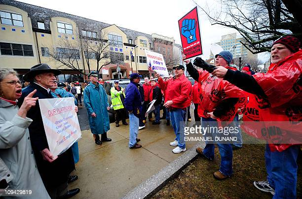 TEA party supporters argue with Union members during a rally outside New Jersey's Statehouse calling for an end to Governor Chris Christie's benefit...