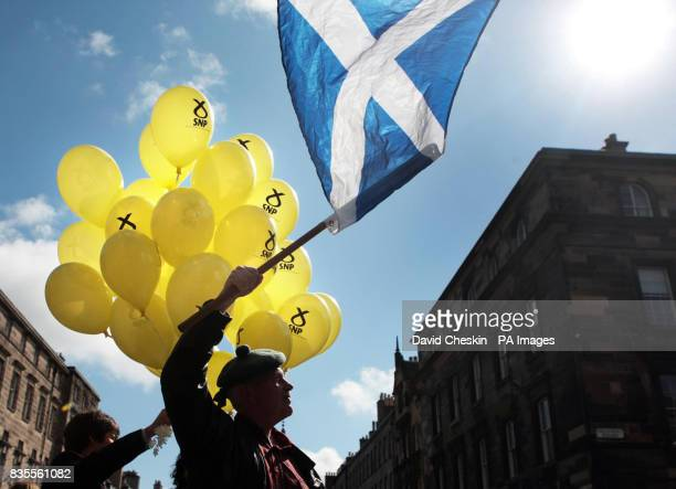 Party supporters gather on Edinburgh's Royal Mile for the results of the European election