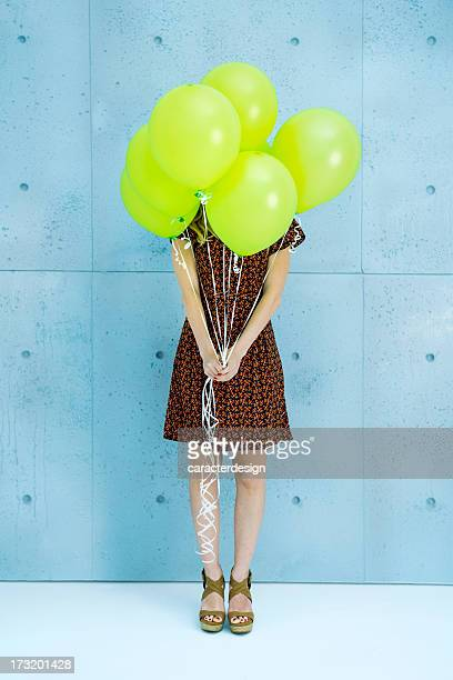 Party surprise with green balloons