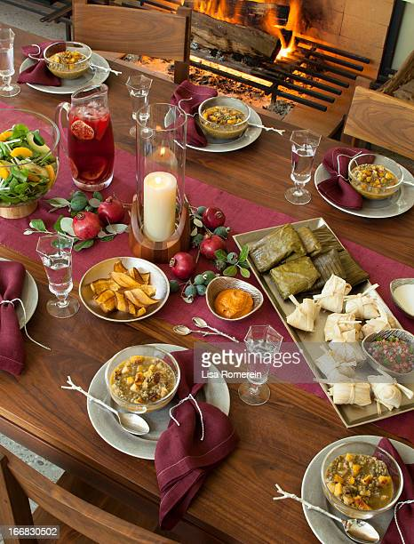 Party table with tamales, lentil soup & drinks