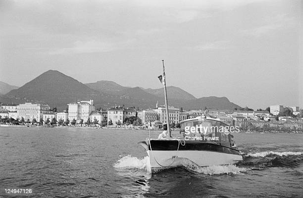 A party take a boat across Lake Maggiore during a coach tour of Italy 1954 Original Publication Picture Post 7325 Coach Tour Of Italy unpub