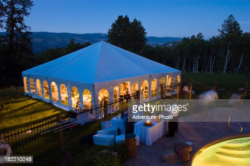 Party Tent Glowing Warm at Dusk with Cool Blue Light