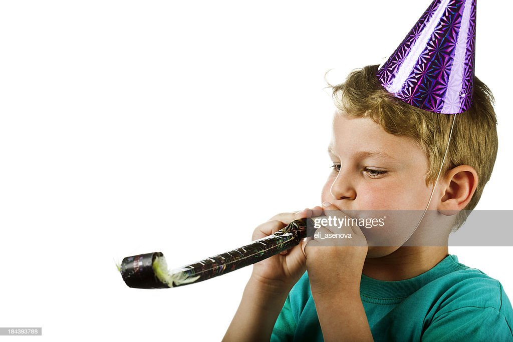 Party time. Boy with horn blower.