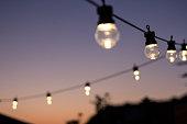 Outdoor string lights hanging in line.