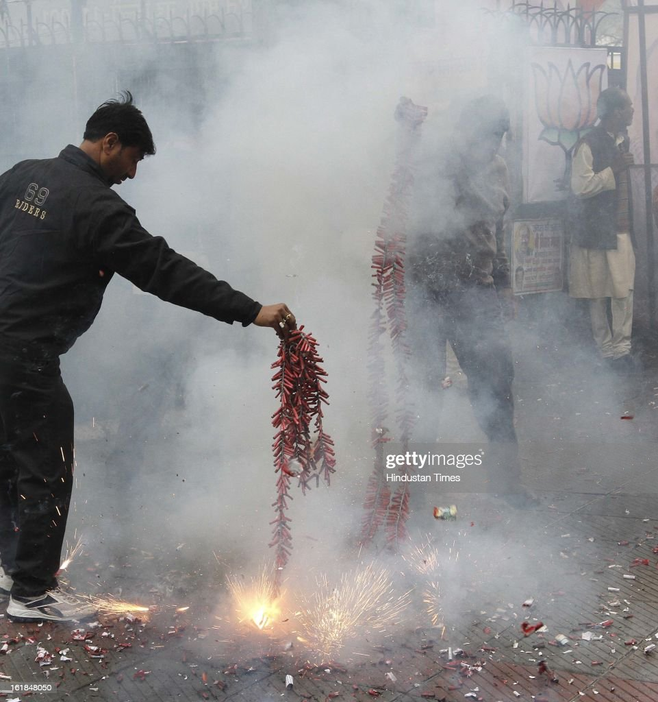 BJP Party workers burst the crackers during arrival of their Newly appointed BJP Delhi Pradesh President Vijay Goel at a function at BJP office on February 17, 2013 in New Delhi, India.