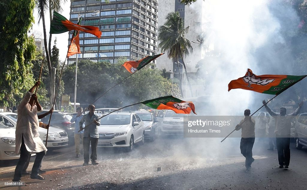 BJP party workers celebrate the completion of two years of the Narendra Modi led NDA government at the Centre, at party headquarters, on May 26, 2016 in Mumbai, India. PM Narendra Modi completed two years in office on May 26.