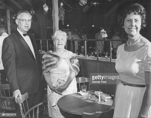 Partygoers At Event Honoring Baroness Kuhn Von Poushental A threesome for the party at the Golden Fiddle were from left William E Bradford Mrs Rollie...
