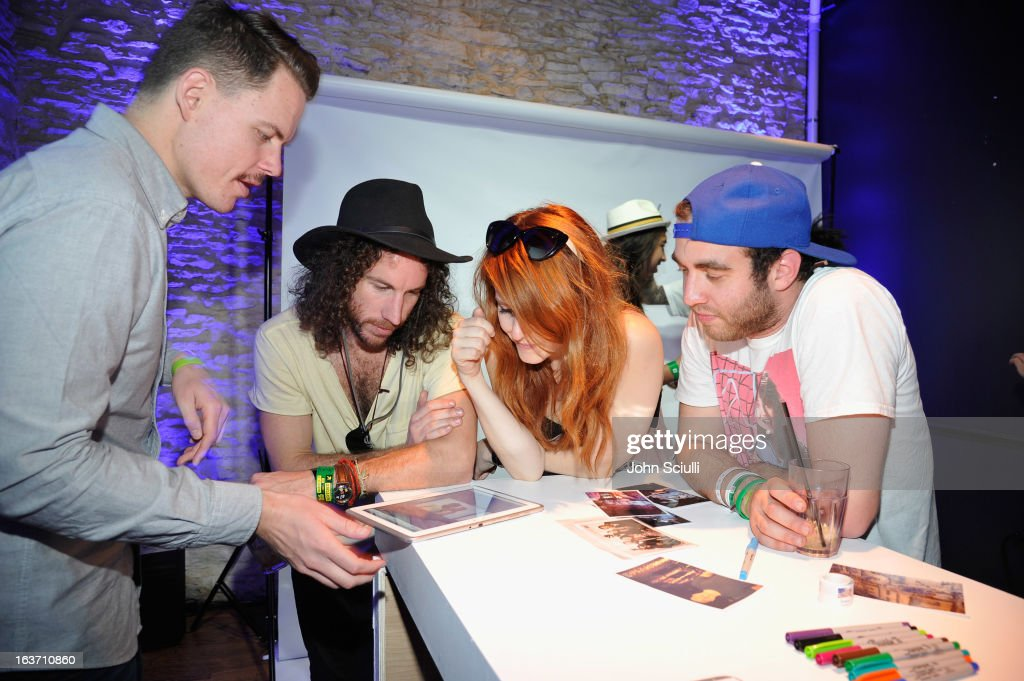 Partygoers attend The Universal Music Group cocktail party hosted by Samsung Galaxy Club at SXSW on March 14, 2013 in Austin, Texas.