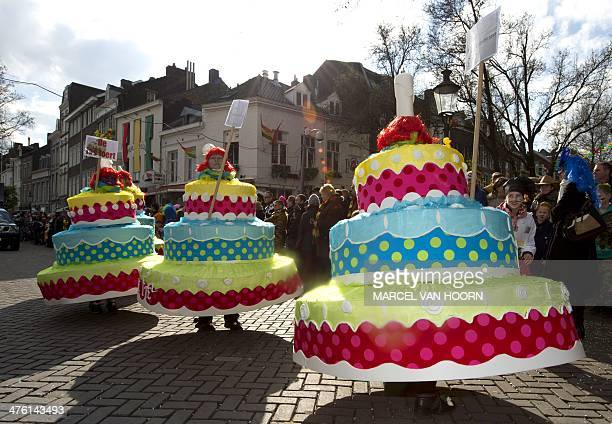 Partygoers dressed like cakes parade during the traditional Carnaval parade in the centre of Maastricht on March 2 2014 AFP PHOTO/ANP MARCEL VAN...