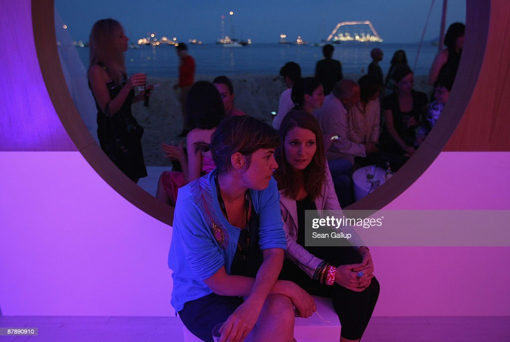 Partygoers mingle at the Martini Terrace beachfront nightclub along the Croisette during the 62nd International Film Festival on May 19 2009 in...