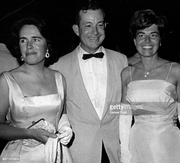 Partygoers Turn out for Formal Dinner Dance Mrs Walter Emery left exchanges party notes with Mr and Mrs W J Stalder Jr at the Presidents' Ball at...