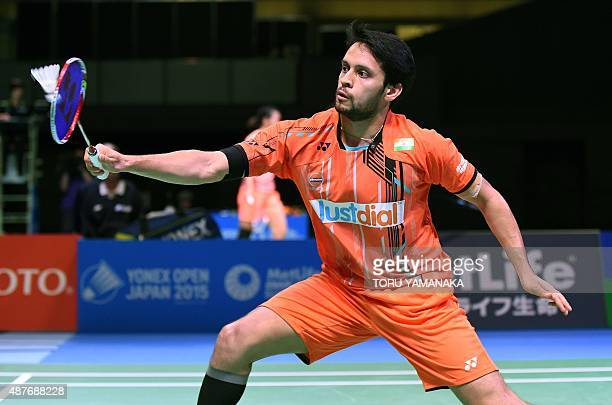 Parupalli Kashyap of India hits a return against Chou Tienchen of Taiwan during their men's singles quarterfinal match at the Japan Open Superseries...