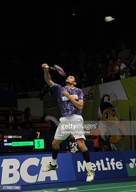 Parupalli Kashyap of India returns a shot against Chen Long of China during the 2015 BCA Indonesia Open Quarterfinals match at Istora Senayan on June...
