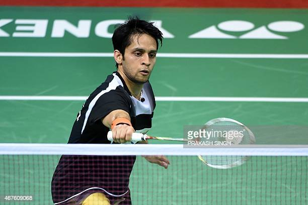 Parupalli Kashyap of India returns a shot to Xue Song of China during the women's singles badminton match at the YonexSunrise India Open 2015 at the...