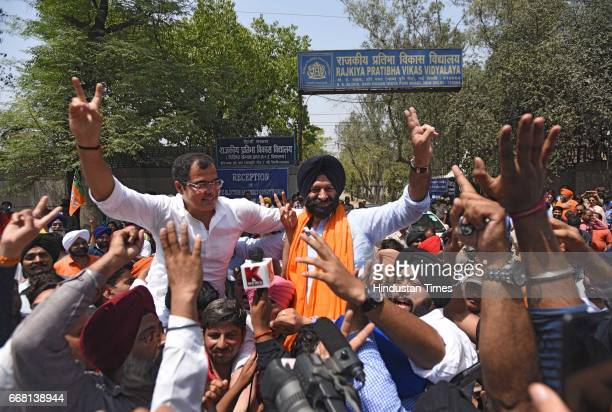 Parvesh Verma and winning candidate Manjinder Singh Sirsa celebrate the victory with supporters in Rajouri Garden bypoll on April 13 2017 in New...