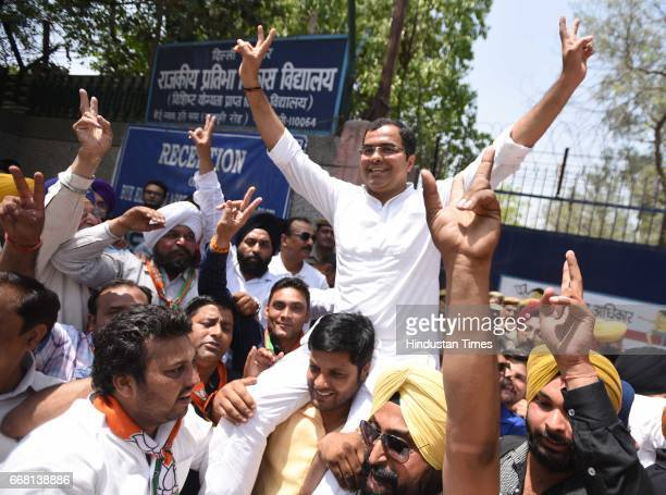 Parvesh Verma with supporters celebrate the victory of party candidate Majinder Singh Sirsa in Rajouri Garden bypoll on April 13 2017 in New Delhi...