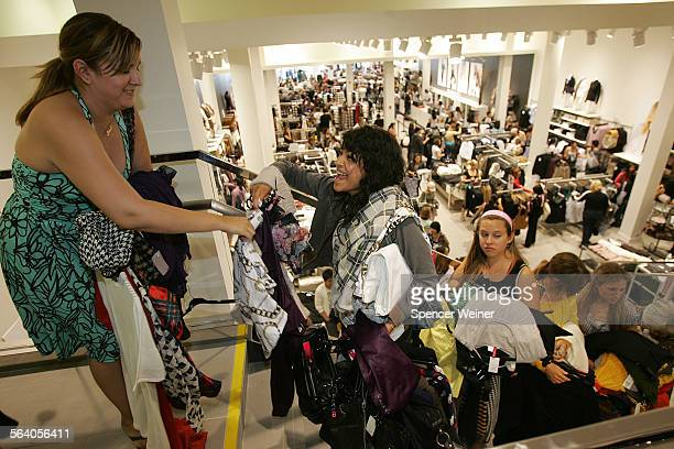 Pasadena Ca– Buying fashion by the armload Lauren Reviere center gets help with her treasures from Claudia Casanova left as the shoppers wait in line...