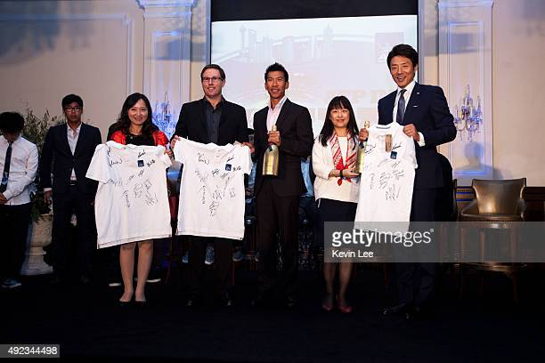 Pasadora Srichapan and Shuzo Matsuoka give to signed Tshirt to winners of a lucky draw at an ATP event on October 12 2015 in Shanghai China