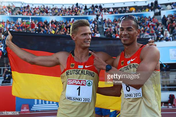 Pascal Behrenbruch of Germany celebrates winning the Men's Decathlon with Norman Muller of Germany during day two of the 21st European Athletics...