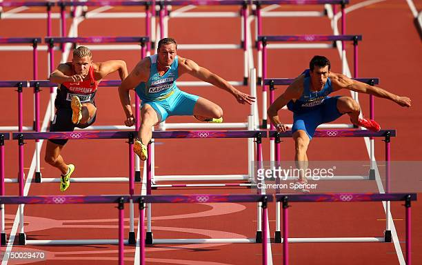 Pascal Behrenbruch of Germany Dmitriy Karpov of Kazakhstan and Oleksiy Kasyanov of Ukraine competes during the Men's Decathlon 110m Hurdles heats on...