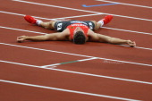 Pascal Behrenbruch of Germany layes on the ground after competing in the Men's Decathlon 400m Heats on Day 12 of the London 2012 Olympic Games at...