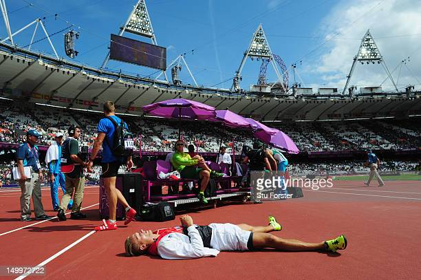 Pascal Behrenbruch of Germany lies onthe ground in the sun after competing in the Men's Decathlon Shot Put on Day 12 of the London 2012 Olympic Games...