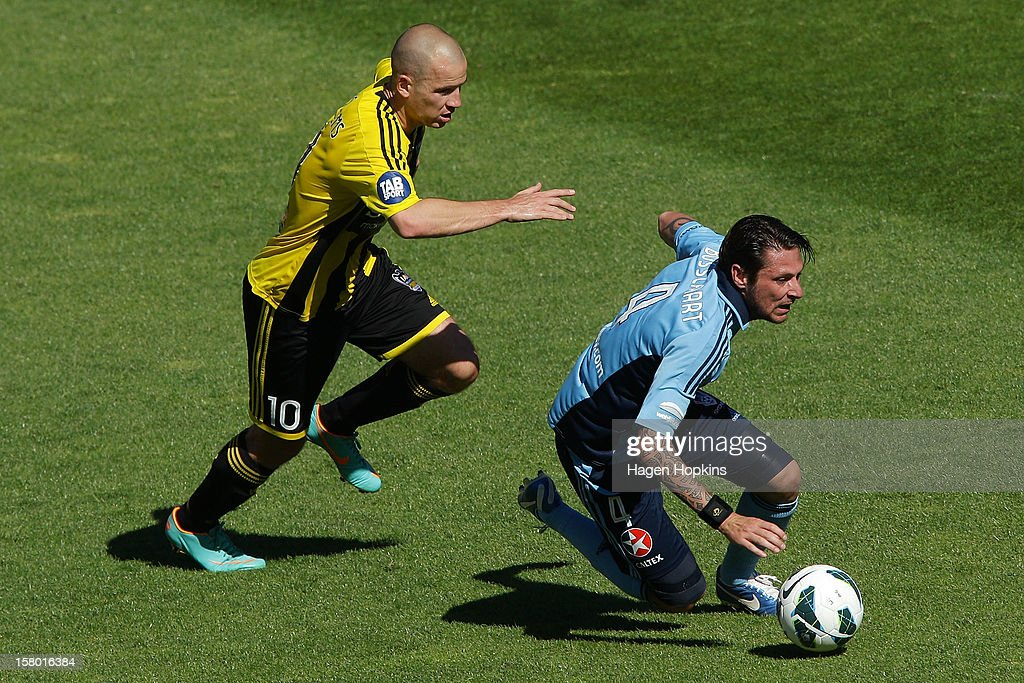 Pascal Bosschaart of Sydney FC loses his footing after a challenge from Stein Huysegems of the Phoenix during the round 10 A-League match between Wellington Phoenix and Sydney FC at Westpac Stadium on December 9, 2012 in Wellington, New Zealand.