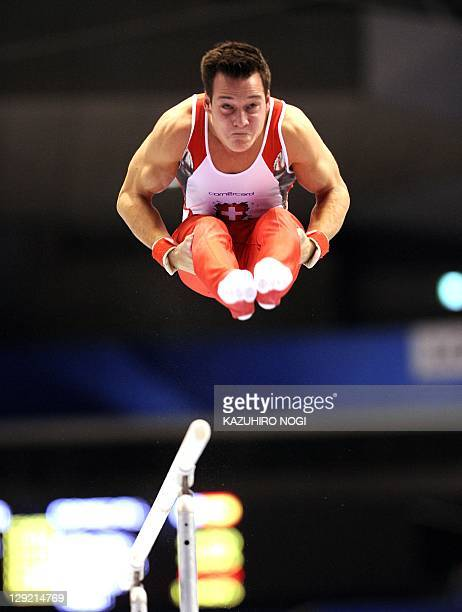 Pascal Bucher of Switzerland performs on the parallel bars during men's individual allaround final of the World Gymnastics Championships in Tokyo on...