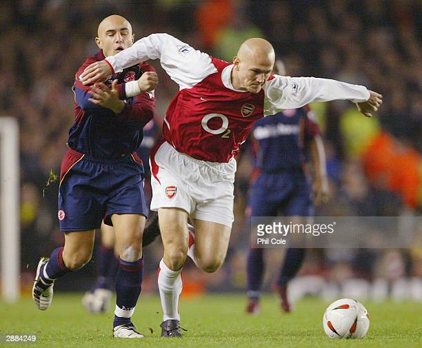 Pascal Cygan of Arsenal battles for the ball with Massimo Maccarone of Middlesbrough during the Carling Cup SemiFinal first leg match between Arsenal...