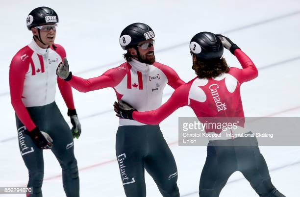 Pascal Dion Charles Hamelin and Samuel Girard of Canada celebrate winnin g the men 5000m relay final A during the Audi ISU World Cup Short Track...