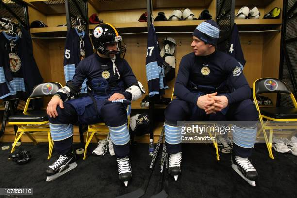 Pascal Dupuis talks with Sidney Crosby of the Pittsburgh Penguins in the locker room prior to practice for the 2011 NHL Bridgestone Winter Classic at...