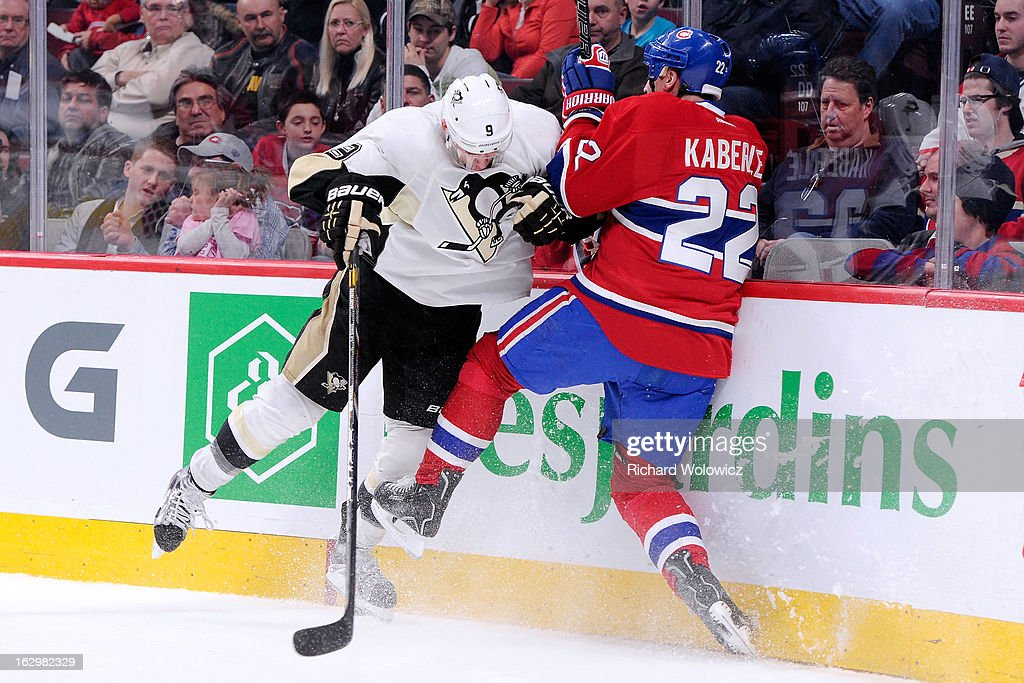 <a gi-track='captionPersonalityLinkClicked' href=/galleries/search?phrase=Pascal+Dupuis&family=editorial&specificpeople=208971 ng-click='$event.stopPropagation()'>Pascal Dupuis</a> #9 of the Pittsburgh Penguins body checks <a gi-track='captionPersonalityLinkClicked' href=/galleries/search?phrase=Tomas+Kaberle&family=editorial&specificpeople=202238 ng-click='$event.stopPropagation()'>Tomas Kaberle</a> #22 of the Montreal Canadiens during the NHL game at the Bell Centre on March 2, 2013 in Montreal, Quebec, Canada. The Penguins defeated the Canadiens 7-6 in overtime.