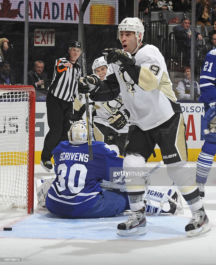 <a gi-track='captionPersonalityLinkClicked' href=/galleries/search?phrase=Pascal+Dupuis&family=editorial&specificpeople=208971 ng-click='$event.stopPropagation()'>Pascal Dupuis</a> #9 of the Pittsburgh Penguins celebrates a third-period goal against the Toronto Maple Leafs during NHL game action March 14, 2013 at the Air Canada Centre in Toronto, Ontario, Canada.