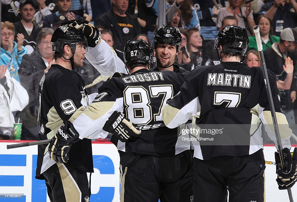 <a gi-track='captionPersonalityLinkClicked' href=/galleries/search?phrase=Pascal+Dupuis&family=editorial&specificpeople=208971 ng-click='$event.stopPropagation()'>Pascal Dupuis</a> #9 of the Pittsburgh Penguins celebrates his goal with teammates during the second period against the New Jersey Devils on March 25, 2012 at Consol Energy Center in Pittsburgh, Pennsylvania.