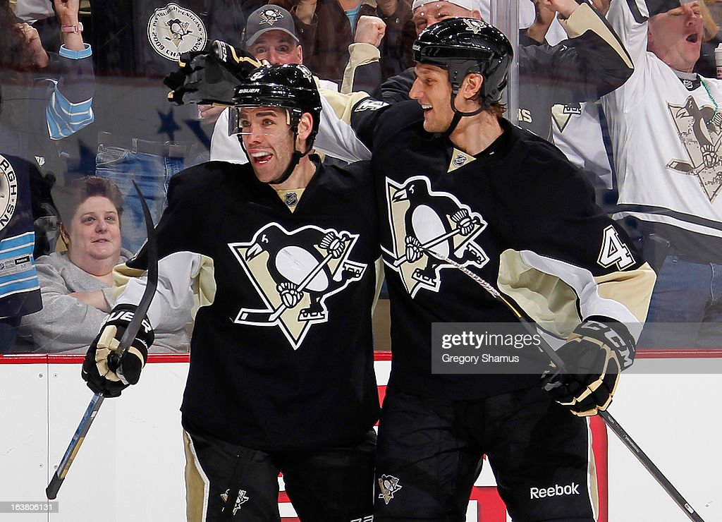 <a gi-track='captionPersonalityLinkClicked' href=/galleries/search?phrase=Pascal+Dupuis&family=editorial&specificpeople=208971 ng-click='$event.stopPropagation()'>Pascal Dupuis</a> #9 of the Pittsburgh Penguins celebrates his goal with Mark Eaton #4 during the third period against the New York Rangers on March 16, 2013 at Consol Energy Center in Pittsburgh, Pennsylvania.