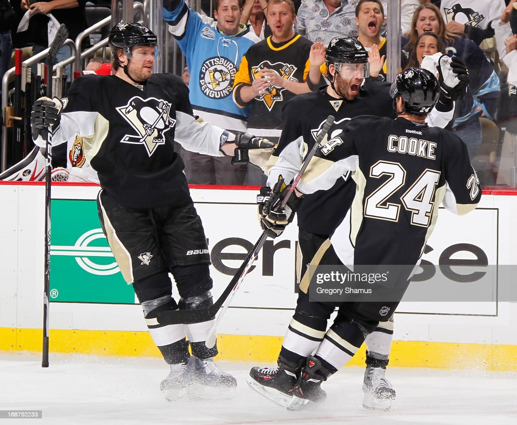 Pascal Dupuis #9 of the Pittsburgh Penguins celebrates his shorthanded goal with Matt Cooke #24 and Douglas Murray #3 in the third period against the Ottawa Senators in Game One of the Eastern Conference Semifinals during the 2013 NHL Stanley Cup Playoffs at Consol Energy Center on May 14, 2013 in Pittsburgh, Pennsylvania. Pittsburgh won the game 4-1.