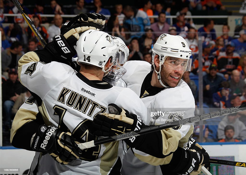 <a gi-track='captionPersonalityLinkClicked' href=/galleries/search?phrase=Pascal+Dupuis&family=editorial&specificpeople=208971 ng-click='$event.stopPropagation()'>Pascal Dupuis</a> #9 of the Pittsburgh Penguins celebrates his third period goal against the New York Islanders in Game Four of the Eastern Conference Quarterfinals during the 2013 NHL Stanley Cup Playoffs at the Nassau Veterans Memorial Coliseum on May 7, 2013 in Uniondale, New York. The Islanders defeated the Penguins 6-4.