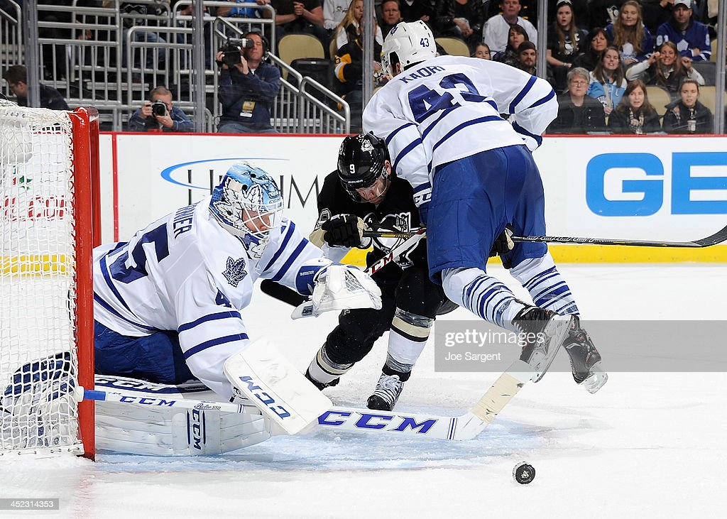 <a gi-track='captionPersonalityLinkClicked' href=/galleries/search?phrase=Pascal+Dupuis&family=editorial&specificpeople=208971 ng-click='$event.stopPropagation()'>Pascal Dupuis</a> #9 of the Pittsburgh Penguins collides with <a gi-track='captionPersonalityLinkClicked' href=/galleries/search?phrase=Nazem+Kadri&family=editorial&specificpeople=4043234 ng-click='$event.stopPropagation()'>Nazem Kadri</a> #43 while skating for the loose puck in front of <a gi-track='captionPersonalityLinkClicked' href=/galleries/search?phrase=Jonathan+Bernier&family=editorial&specificpeople=540491 ng-click='$event.stopPropagation()'>Jonathan Bernier</a> #45 of the Toronto Maple Leafs on November 27, 2013 at Consol Energy Center in Pittsburgh, Pennsylvania.