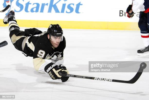 Pascal Dupuis of the Pittsburgh Penguins dives for the puck against the Washington Capitals on April 6 2010 at Mellon Arena in Pittsburgh Pennsylvania
