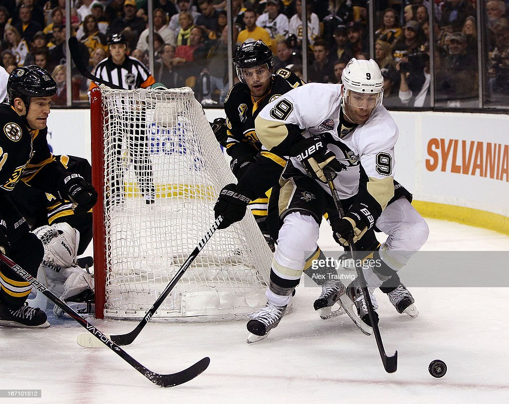 Pascal Dupuis #9 of the Pittsburgh Penguins handles the puck as Daniel Paille #20 and Andrew Ference #21 of the Boston Bruins defend at the TD Garden on April 20, 2013 in Boston, Massachusetts.