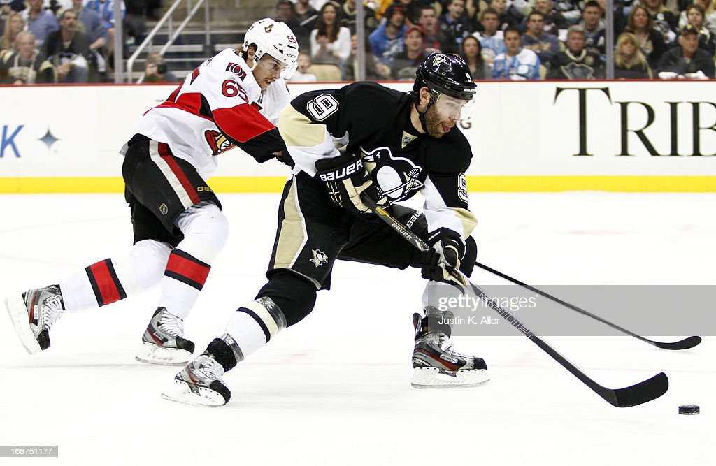 Pascal Dupuis #9 of the Pittsburgh Penguins handles the puck in front of Erik Karlsson #65 of the Ottawa Senators in Game One of the Eastern Conference Semifinals during the 2013 NHL Stanley Cup Playoffs at Consol Energy Center on May 14, 2013 in Pittsburgh, Pennsylvania.