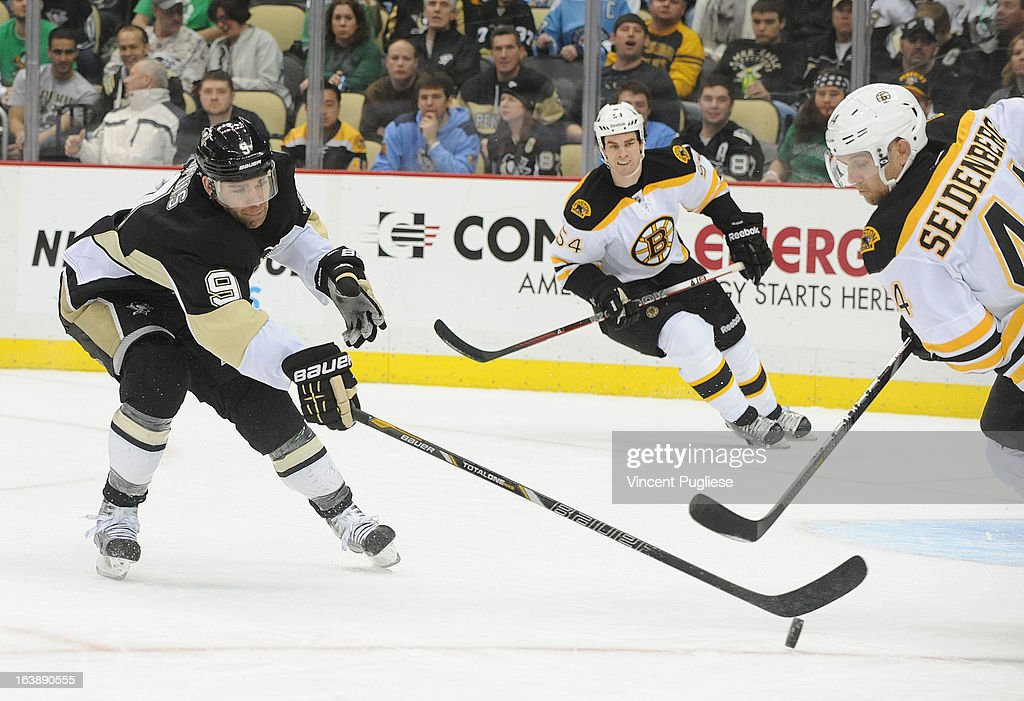 <a gi-track='captionPersonalityLinkClicked' href=/galleries/search?phrase=Pascal+Dupuis&family=editorial&specificpeople=208971 ng-click='$event.stopPropagation()'>Pascal Dupuis</a> # 9 of the Pittsburgh Penguins knocks the puck off of the stick of <a gi-track='captionPersonalityLinkClicked' href=/galleries/search?phrase=Dennis+Seidenberg&family=editorial&specificpeople=204616 ng-click='$event.stopPropagation()'>Dennis Seidenberg</a> # 44 of the Boston Bruins during the first period on February 17, 2013 at the CONSOL Energy Center in Pittsburgh, Pennsylvania.