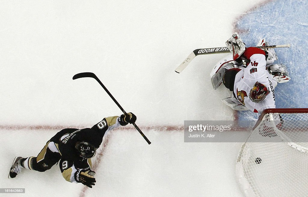 Pascal Dupuis #9 of the Pittsburgh Penguins scores past Craig Anderson #41 of the Ottawa Senators during the game at Consol Energy Center on February 13, 2013 in Pittsburgh, Pennsylvania. The Penguins won 4-2.