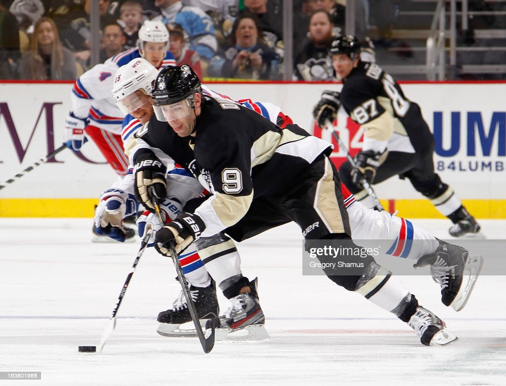 <a gi-track='captionPersonalityLinkClicked' href=/galleries/search?phrase=Pascal+Dupuis&family=editorial&specificpeople=208971 ng-click='$event.stopPropagation()'>Pascal Dupuis</a> #9 of the Pittsburgh Penguins skates past he defense of <a gi-track='captionPersonalityLinkClicked' href=/galleries/search?phrase=Jeff+Halpern&family=editorial&specificpeople=206583 ng-click='$event.stopPropagation()'>Jeff Halpern</a> #15 of the New York Rangers on March 16, 2013 at Consol Energy Center in Pittsburgh, Pennsylvania.