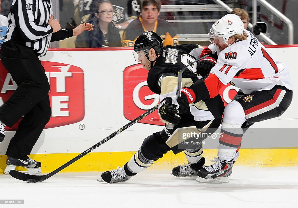 <a gi-track='captionPersonalityLinkClicked' href=/galleries/search?phrase=Pascal+Dupuis&family=editorial&specificpeople=208971 ng-click='$event.stopPropagation()'>Pascal Dupuis</a> #9 of the Pittsburgh Penguins skates past the defense of <a gi-track='captionPersonalityLinkClicked' href=/galleries/search?phrase=Daniel+Alfredsson&family=editorial&specificpeople=201853 ng-click='$event.stopPropagation()'>Daniel Alfredsson</a> #11 of the Ottawa Senators on February 13, 2013 at Consol Energy Center in Pittsburgh, Pennsylvania. Pittsburgh won the game 4-2.