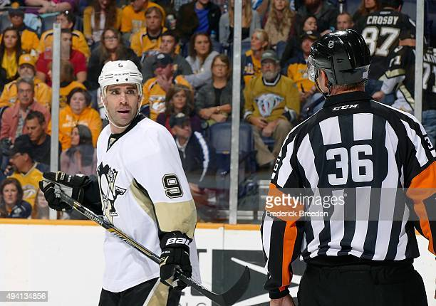 Pascal Dupuis of the Pittsburgh Penguins speaks to an official during the first period of a game against of the Nashville Predators at Bridgestone...