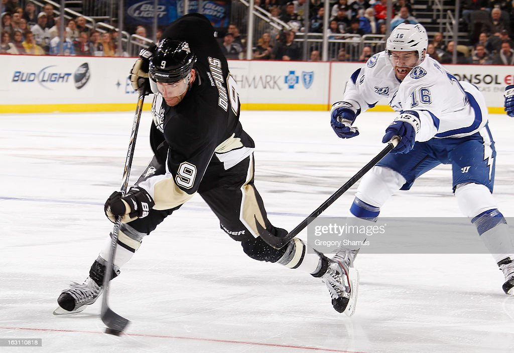 <a gi-track='captionPersonalityLinkClicked' href=/galleries/search?phrase=Pascal+Dupuis&family=editorial&specificpeople=208971 ng-click='$event.stopPropagation()'>Pascal Dupuis</a> #9 of the Pittsburgh Penguins takes a shot in front of <a gi-track='captionPersonalityLinkClicked' href=/galleries/search?phrase=Teddy+Purcell&family=editorial&specificpeople=4537302 ng-click='$event.stopPropagation()'>Teddy Purcell</a> #16 of the Tampa Bay Lightning on March 4, 2013 at Consol Energy Center in Pittsburgh, Pennsylvania. Pittsburgh won the game 4-3