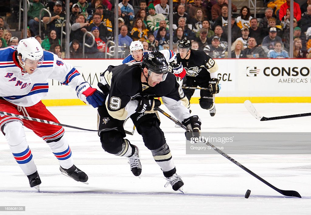 <a gi-track='captionPersonalityLinkClicked' href=/galleries/search?phrase=Pascal+Dupuis&family=editorial&specificpeople=208971 ng-click='$event.stopPropagation()'>Pascal Dupuis</a> #9 of the Pittsburgh Penguins tries to get around the defense of <a gi-track='captionPersonalityLinkClicked' href=/galleries/search?phrase=Michael+Del+Zotto&family=editorial&specificpeople=4044191 ng-click='$event.stopPropagation()'>Michael Del Zotto</a> #4 of the New York Rangers on March 16, 2013 at Consol Energy Center in Pittsburgh, Pennsylvania.