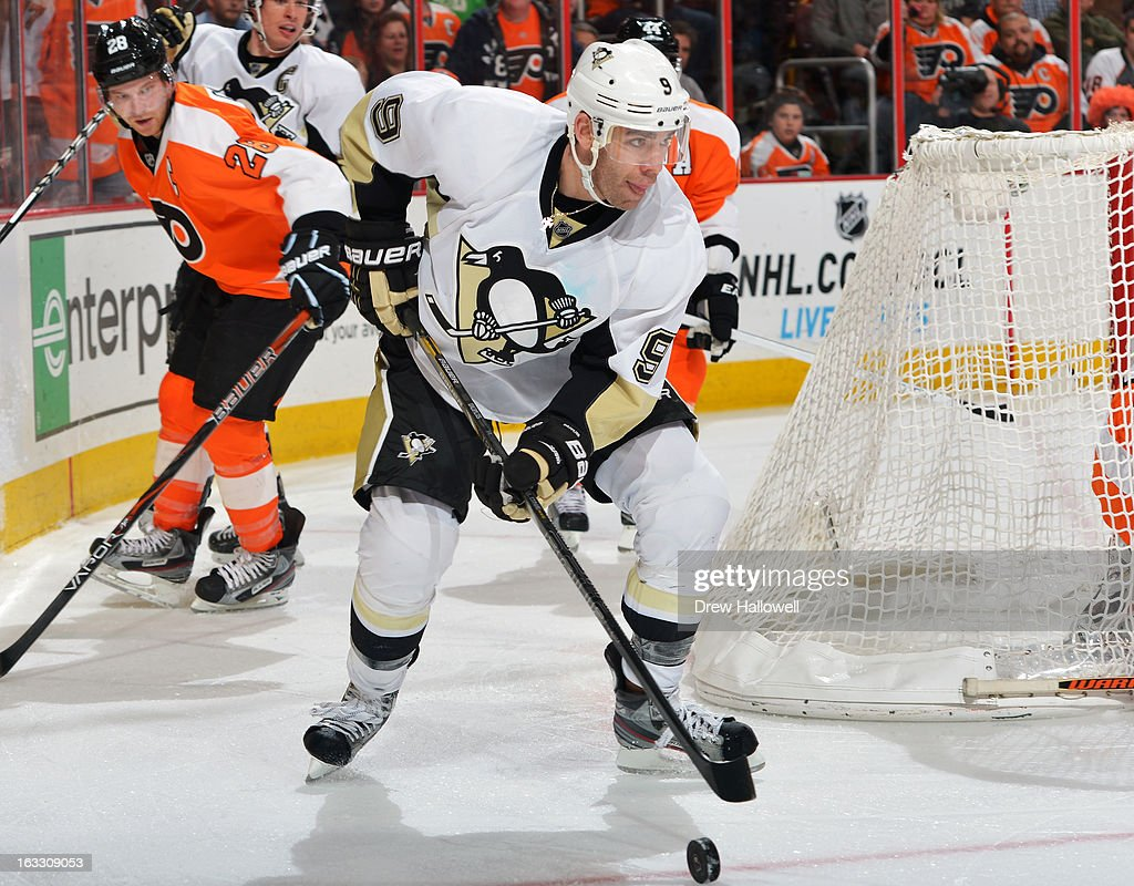Pascal Dupuis #9 of the Pittsburgh Penguins works his way around the net during the game against the Philadelphia Flyers at the Wells Fargo Center on March 7, 2013 in Philadelphia, Pennsylvania. The Penguins won 5-4.